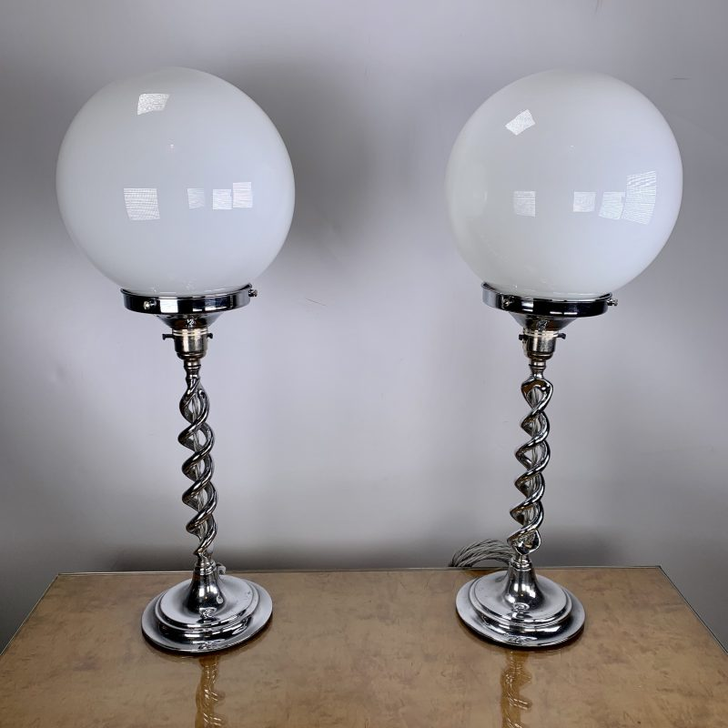 Pair of Twisted Chrome Stem Lamps with White Globe Lights